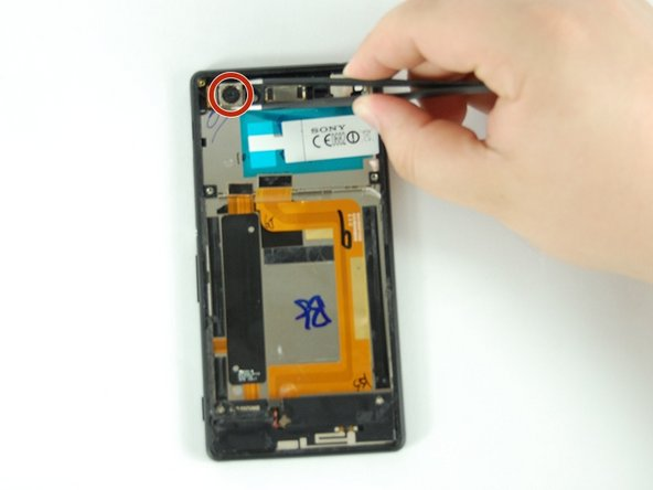 With your fingers, detach front camera connector from the back of motherboard.