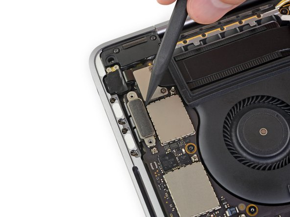 Use a spudger to disconnect the left-side Thunderbolt port connector by prying it straight up from the logic board.