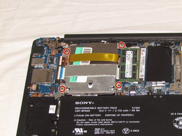 Remove the four 3.20mm Phillips #00 screws from the hard drive.