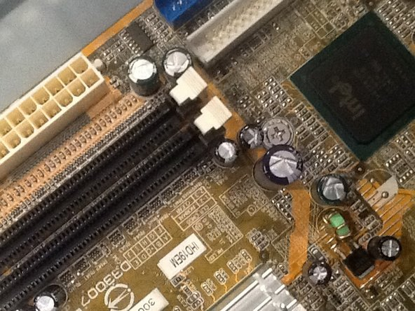Remove the six screws from the motherboard, one in each corner and two in the middle in between these