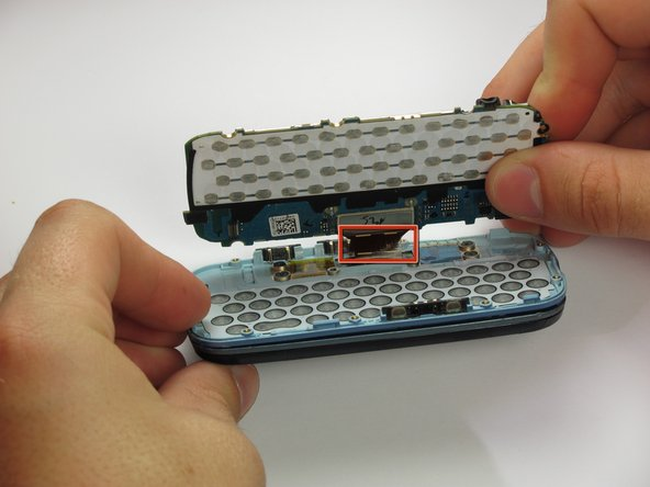 You may need to pry the circuit board in multiple locations to fully loosen it from the phone.