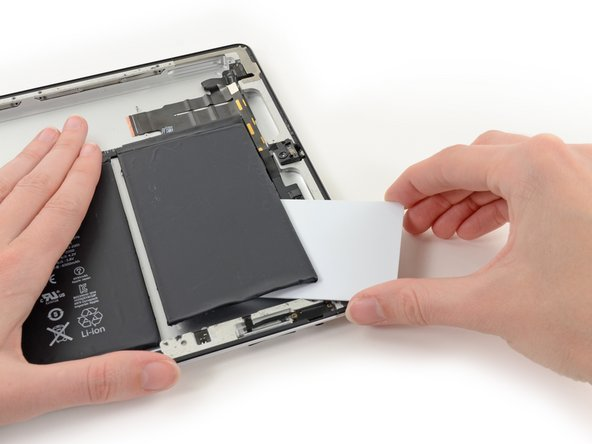 A final pry, and the card can be left in place to keep the battery propped away from the adhesive.