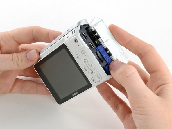 Use a spudger or fingernail to open the battery compartment on the right side of the camera.