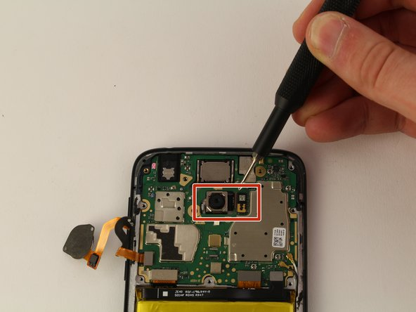 Once the motherboard cover is removed, use the iFixit opening tool to disconnect the ribbon cable connecting the camera to the motherboard.