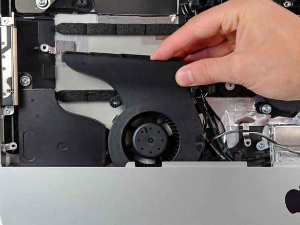 Pull the CPU fan straight up from its mounting pin near the bottom edge of the iMac.