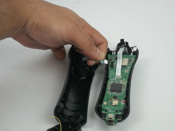 Image 3/3: Be careful to gently detach it from the motherboard. The strip may rip if too much strength is applied.