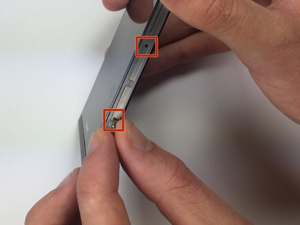 Insert the pin into the SIM card opening located on the right-side of the phone.