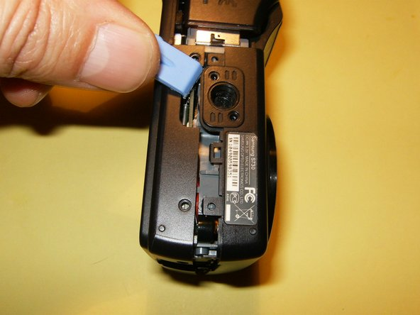 Split the case from the battery compartment down. You can use an opening tool or your fingernails to accomplish that.