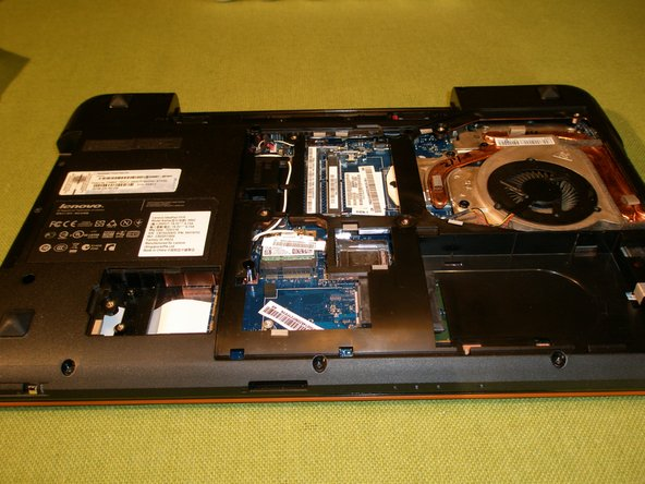 Remove the 1 retaining screw from the solid state hard drive, slide the drive out of the socket and remove from the unit.