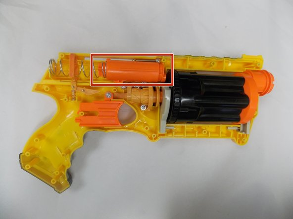 Follow steps 1 through 4 of the Nerf N-Strike Maverick Teardown guide.