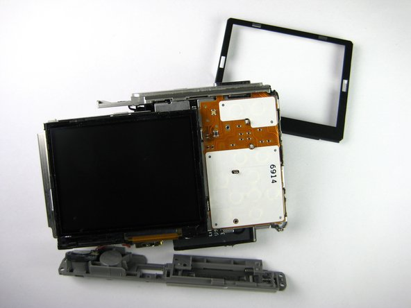 The LCD screen is now loose from the camera; it should only be connected by a gold strip that attaches to the circuit board.