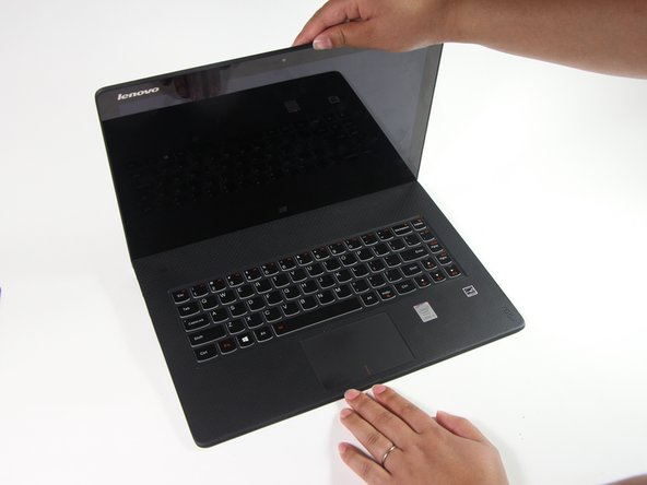 Gently open the laptop to separate the screen from the laptop chassis.