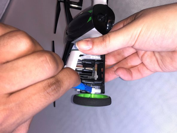 Use the opening tool to separate the drone's body from the drone's shock absorber.