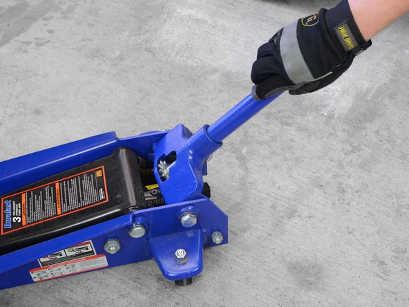 Image 1/2: Don't use your vehicle's emergency jack for routine repairs. The emergency jack is for ''emergencies'', such as when you need to change a flat tire. A hydraulic floor jack of the sort pictured here is sturdier, more durable, and better suited to general maintenance and repair.