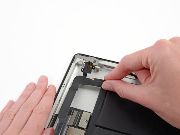 Grasping the headphone jack assembly with one hand, pull the assembly from the iPad, minding any cables that may get caught.