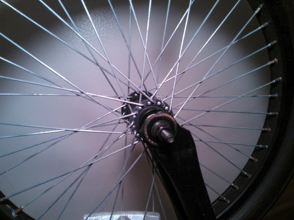 Image 1/3: Now that the bolts are loose you may remove the wheel from the bike.