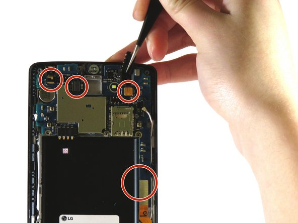 Use the tweezers to remove the four connectors as well as the back camera.