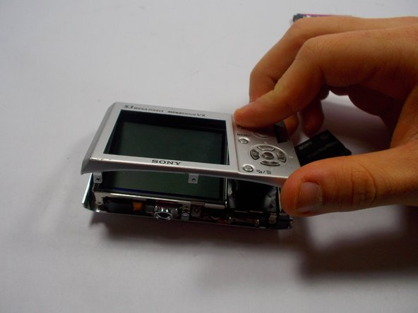 Remove the back cover panel from the rest of the camera.