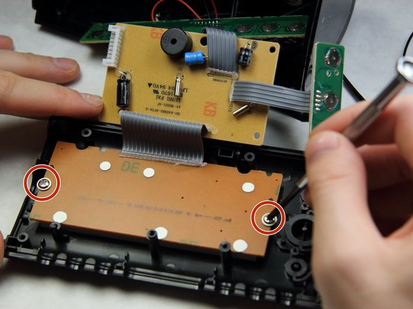 Move the now free circuit boards away from the display.