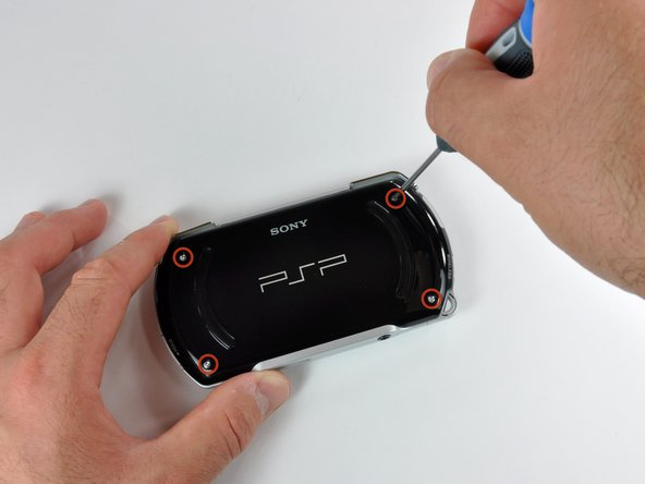 Image 1/2: Rotate the PSP so you can see the top of the device.
