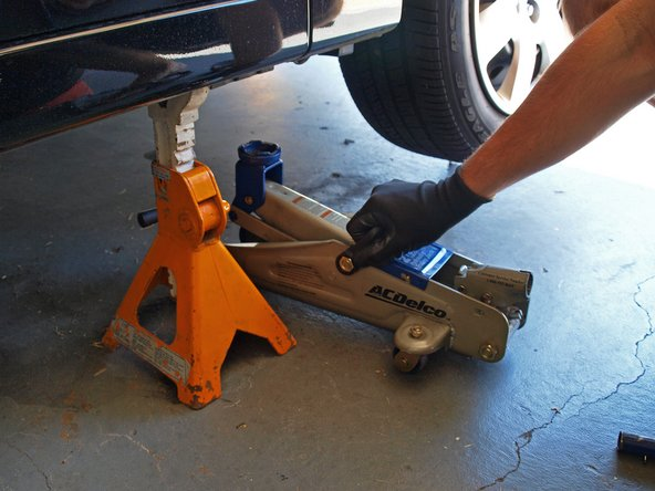 Slowly lower the car onto the jack stand and remove the jack.
