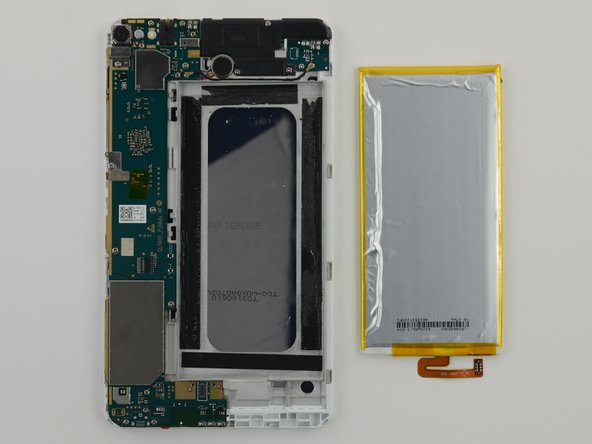 Battery rests against the back of the display assembly, the gap in the midframe is ringed by four pieces of thick tape.