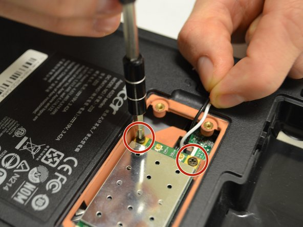 Remove the two 0.5mm Phillips #1 black screws located on the WiFi card.