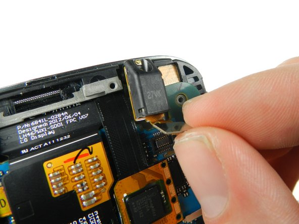 Gently lift the audio jack upwards and to the left to remove it from the motherboard.