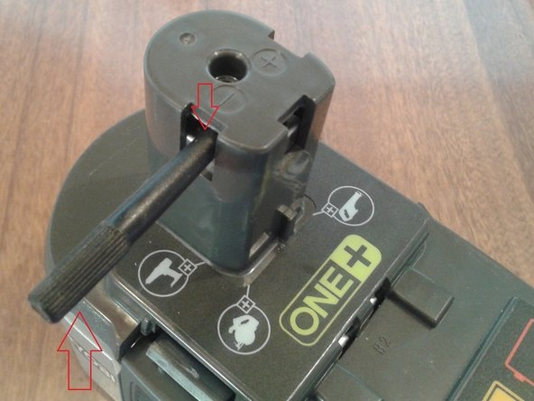 Using an insulated instrument, lever the battery terminal assembly down inside the top cover.