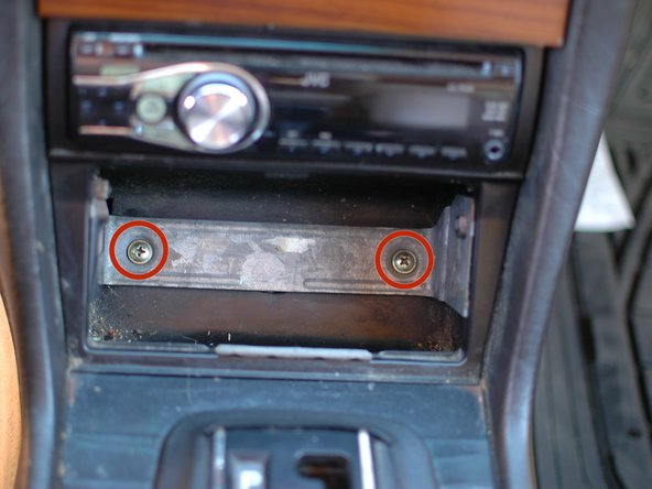If you want to remove the entire assembly including the bracket that the ash tray rests in you can proceed to remove the two screws that hold it to the center console.