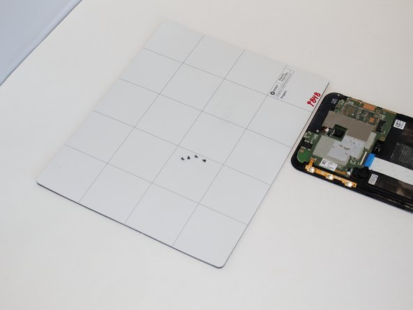 Use the magnetic board to keep track of your screws.