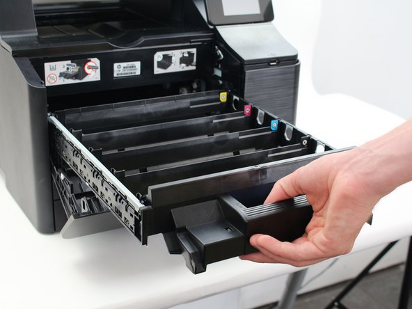 Pull out the faulty ink cartridge drawer and replace it with a functioning drawer.