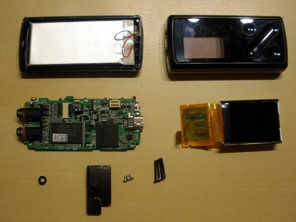 All parts disassembled. Second photo shows back side of the PCB.