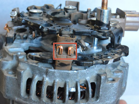 Locate the copper leads connecting the stator to the bridge assembly. There are 3 sets of 2 leads on the perimeter of the bridge, making 6 leads total.