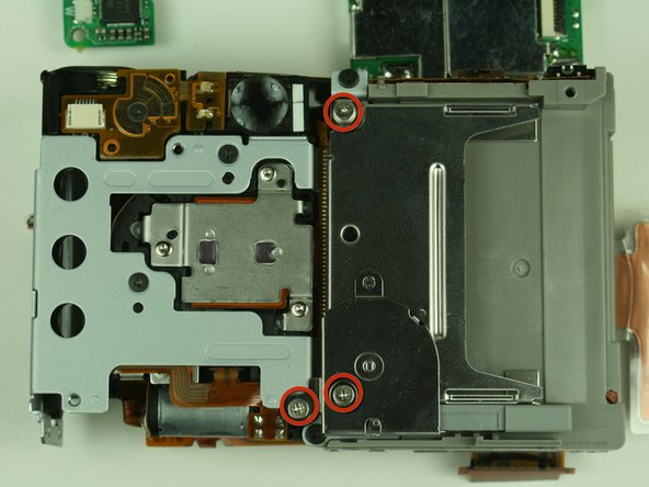 Locate and remove the three 3.45mm screws on the backside of the camera that secure the CF card slot.