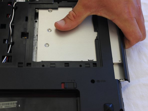 Optical Drive should slide out easily with one thumb's effort.