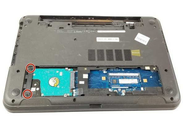 Lift the access panel away from the laptop to reveal the hard drive on the left.