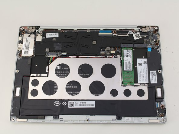 Remove the back of the laptop by gently lifting the casing upwards.