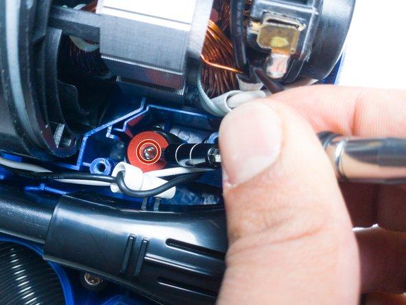 Unscrew the 22.3mm PH2 Phillips head screw.