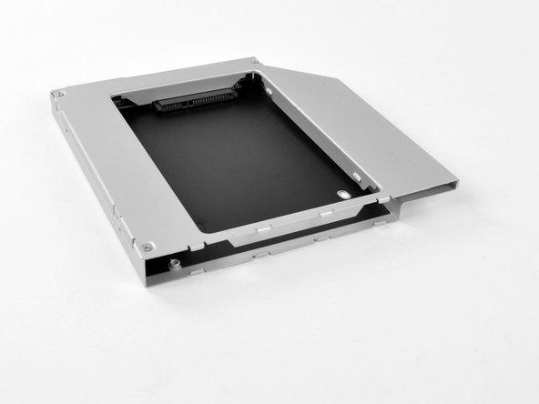 Remontez le boîtier de la baie optique sans la façade, en réutilisant les trois vis Phillips 3,0 mm d'origine afin de ne pas l'endommager.