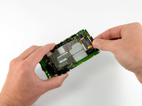 First thing off the motherboard: the front-facing camera/ear speaker assembly.