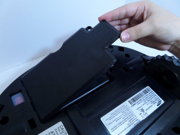 Lift the cover plate to expose the battery.