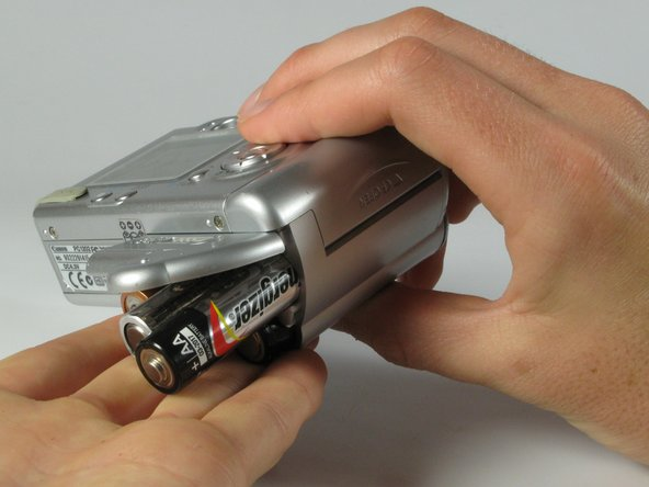 Image 1/3: Watch for the orientation of the batteries as they slide out.