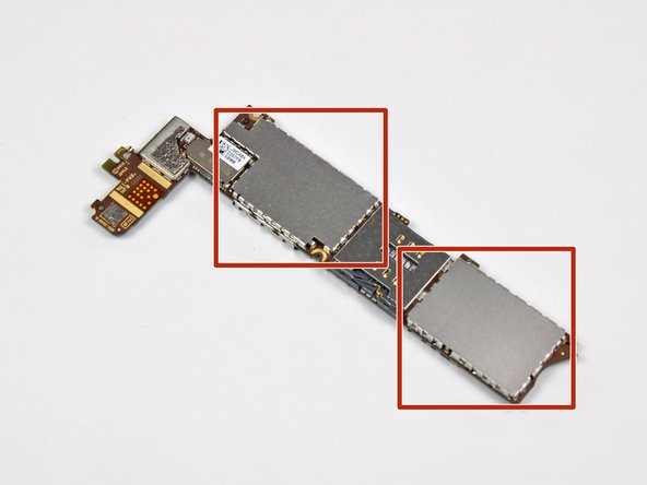 Image 2/3: On an iPhone 4 or older, use a set of tweezers or your fingers to pull off the EMI shields.