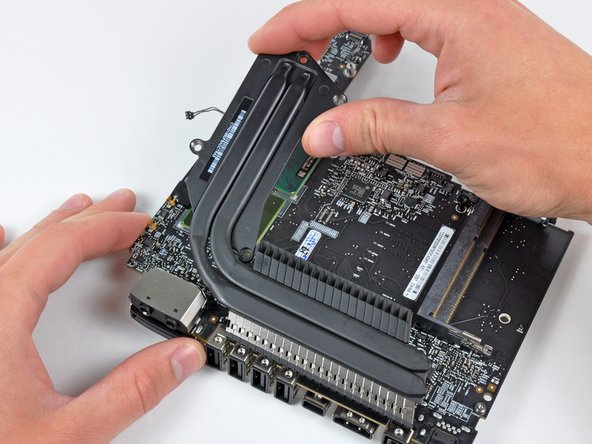 Image 1/1: If the heat sink appears to be stuck to the logic board after removing all six screws, it may be helpful to use a spudger to separate the two components.