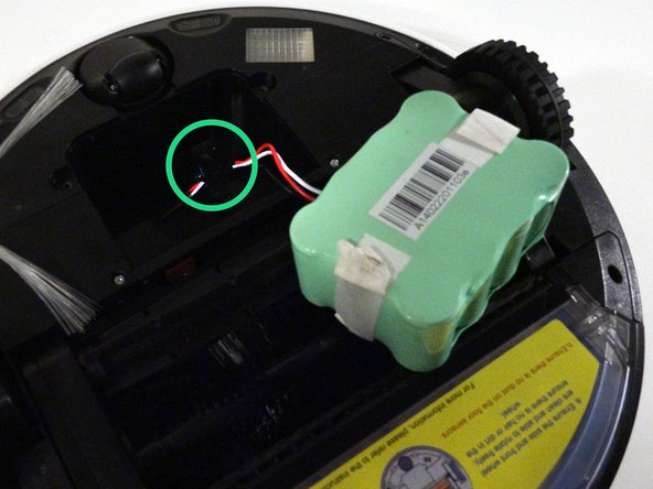 Image 2/3: Tuck the wire into the side of the battery. do not push it underneath the battery itself.