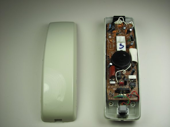Pull apart the handset by pulling the shell away from the other half of the phone.