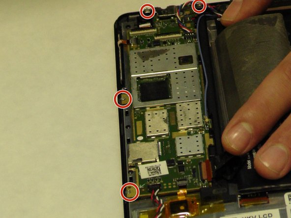Use a JIS screw bit #00 to remove screws around the motherboard.