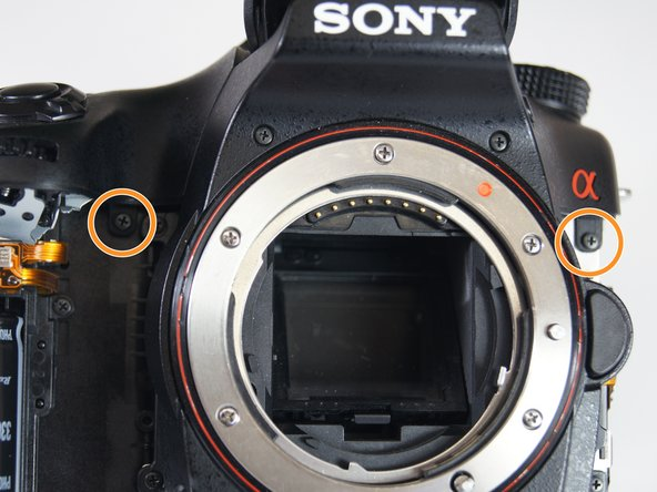 Remove the three 5.0 mm Phillips #00 screws on the front and left side of the camera.