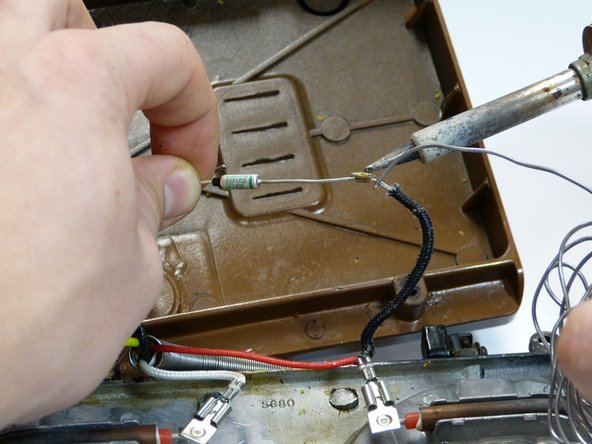 Solder the new thermal fuser on the cable, using the soldering machine.